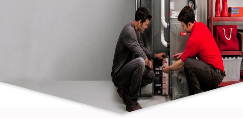 Air Cleaner being shown to customer by Global Heating Services Technician